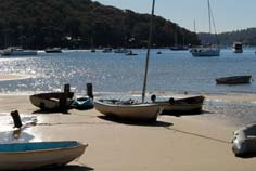 sydney northern beaches - boats on a beach, pittwater